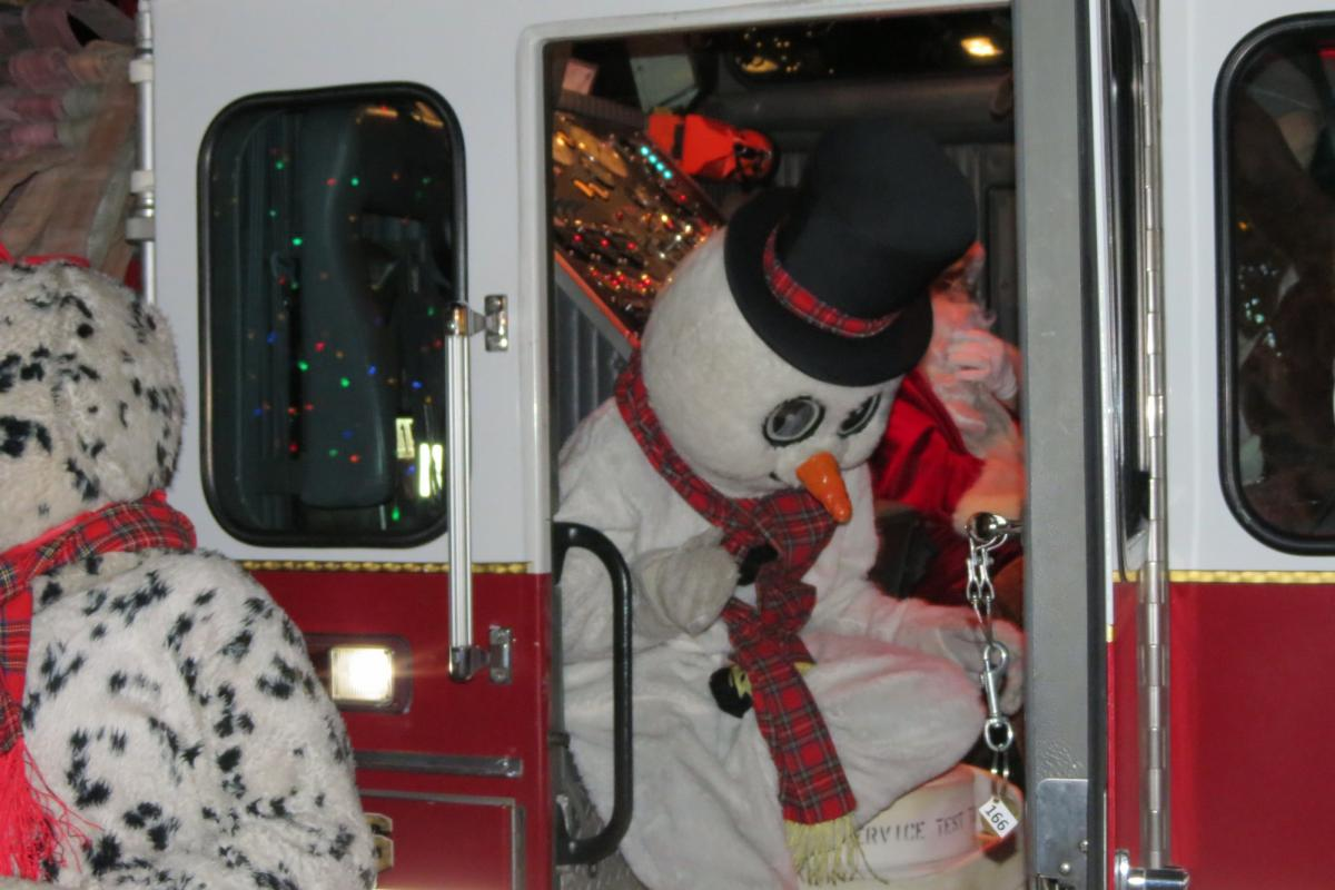 Snowman getting out of firetruck